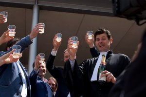 Urgenda Foundation lawyer Roger Cox, right, proposes a toast on the steps of the court house in a scene setup by TV in The Hague, Netherlands, Wednesday, June 24, 2015. A Dutch court has ordered the government to cut the country's greenhouse gas emissions by at least 25 percent by 2020 in a groundbreaking climate case that activists hope will set a worldwide precedent. The Hague District Court made the ruling Wednesday in a case brought by a sustainability organization on behalf of some 900 citizens, claiming that the the government has a duty of care to protect its citizens against looming dangers. (AP Photo/Peter Dejong)