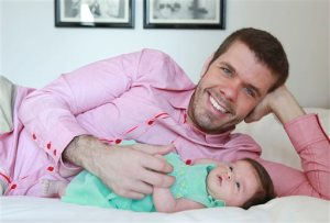 This Sunday, June 7, 2015 photo shows Perez Hilton and his new daughter Mia posing for a portrait at the Sofitel, in New York. Hilton's first Father's Day with his baby girl will be on Sunday, June 21. The 37-year-old celebrity blogger (real name: Mario Lavanderia) started his family in 2013 when son Mario was born via surrogate. (Photo by Amy Sussman/Invision/AP)