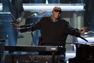 "FILE - In this Feb. 10, 2015, file photo, Stevie Wonder takes in applause from the audience during the finale of ""Stevie Wonder: Songs in the Key of Life - An All-Star Grammy Salute,"" at the Nokia Theatre L.A. Live, in Los Angeles. Organizers of the Special Olympics World Games announced Thursday, June 18, 2015, that Wonder, Cody Simpson, Avril Lavigne and several other stars will perform during the games' opening ceremonies in Los Angeles on Saturday, July 25. The event, held every four years, will feature 7,000 athletes and tens of thousands of spectators from around the world. (Photo by Chris Pizzello/Invision/AP, File)"