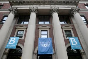 In this Thursday, May 28, 2015 photo, banners hang from a building at Barnard College in New York. Barnard, like other women's colleges, has always admitted only students born as women, but the class of 2020 may be different. Soon Barnard's trustees vote on whether to officially admit transgender students _ trans women, trans men or those not identifying with either gender _ following new policies announced at several other women's colleges. (AP Photo/Seth Wenig)