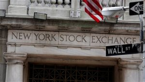 FILE  - This Oct. 2, 2014 file photo shows the Wall Street entrance of the New York Stock Exchange.   Global shares rose Wednesday, June 24, 2015, and Japan's benchmark hit an 18-year high, amid optimism about a bailout deal between Greece and its creditors. (AP Photo/Richard Drew, File)