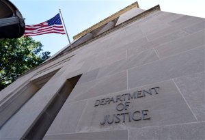 The view of the Justice Department in Washington, Thursday, Aug. 27, 2015. The Associated Press sued the U.S. Department of Justice Thursday over the FBI's failure to provide public records related to the creation of a fake news story used to plant surveillance software on a suspect's computer. (AP Photo/Susan Walsh)