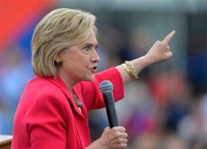 In this photo taken Aug. 27, 2015, Democratic presidential candidate Hillary Rodham Clinton speaks in Cleveland. The State Department is expected to release roughly 7,000 pages of former Secretary of State Hillary Rodham Clinton's emails later Monday, including about 150 that have been censored because they contain information that has now been deemed classified.  (AP Photo/David Richard)