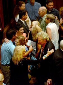 Alison Parker's parents Andy, right, and Barbara Parker, center, hugging, following the interfaith prayer service at the Jefferson Center in Roanoke, Va., on Sunday, Aug. 30, 2015. Community religious leaders gathered Sunday to remember 24-year-old reporter Alison Parker and 27-year-old cameraman Adam Ward, the two television journalists who were shot and killed while working last week. (Natalee Waters/The Roanoke Times via AP)