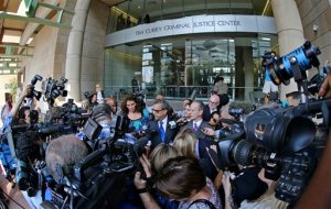 Surrounded by news media, special prosecutors Kent Schaffer center left, and Brian Wice, center right, speak after the morning court session in District Judge George Gallagher's court in Fort Worth, Texas, Thursday, Aug. 27, 2015. Texas Attorney Gen. Ken Paxton pleaded not guilty Thursday to charges alleging that he defrauded investors before he became the state's top lawyer. (Paul Moseley/Star-Telegram via AP) MAGS OUT; (FORT WORTH WEEKLY, 360 WEST); INTERNET OUT; MANDATORY CREDIT