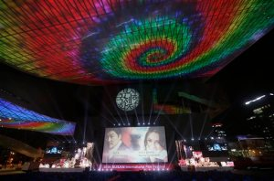 A screen shows Afghanistan actress Marina Golbahari, right, and South Korean actor Song Kang-ho on the eve of the opening ceremony of the Busan International Film Festival at Busan Cinema Center in Busan, South Korea. Wednesday, Sept. 30, 2015. Asia's largest movie festival kicks off Thursday at a time when the region's influence on the global movie industry is on the rise.(AP Photo/Ahn Young-joon)