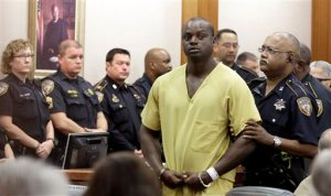 Shannon Miles is escorted out of a courtroom after a hearing, Monday, Aug. 31, 2015, in Houston. Miles has been charged with capital murder in the death of Harris County Sheriff's Deputy Darren Goforth. He is being held without bond. (AP Photo/Pat Sullivan)