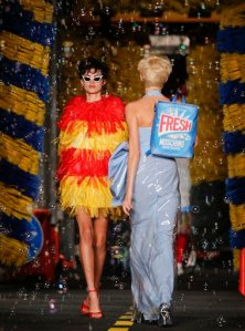 Models wears creations for Moschino women's spring-summer 2016 collection, part of the Milan Fashion Week, unveiled in Milan, Italy, Thursday, Sept. 24, 2015. (AP Photo/Luca Bruno)