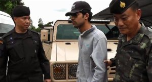 In this image provided by the National Council for Peace and Order (NCPO) Thai authorities arrest a man they believe is part of a group responsible for a deadly bombing at a shrine in central Bangkok on Aug. 17, 2015. Prime Minister Prayuth Chan-ocha told reporters on Tuesday, Sept. 1, 2015, that the man is a foreigner and was detained in eastern Thailand near the Cambodian border, one of several border crossings where authorities set up checkpoints after the bombing which killed 20 people, many of them foreign tourists, and injured more than 120. (National Council for Peace and Order via AP)