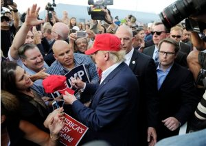 Republican presidential candidate Donald Trump, center, greets supporter after speaking at a campaign event aboard the USS Iowa battleship in Los Angeles Tuesday, Sept. 15, 2015. (AP Photo/Kevork Djansezian)