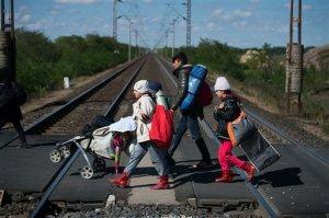 Migrants cross a railway on their way to the Austrian - Hungarian border near Hegyeshalom, Hungary, on Monday Sept. 28, 2015. (AP Photo/Christian Bruna)
