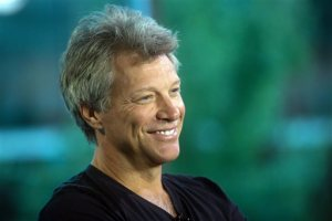 FILE - In this Aug. 22, 2015 file photo, musician Jon Bon Jovi smiles during media interviews in Vancouver, British Columbia. Bon Jovi has added a second concert in Taiwan September, 2015, after the rock group's concerts in China were abruptly canceled.  The event promoter Live Nation Taiwan announced Thursday night, Sept. 10, 2015, on Facebook the second performance would be on Sept. 29, the day after the previously scheduled concert. AEG Live Asia has declined to say why performances Sept. 14 in Shanghai and Sept. 17 in Beijing were canceled.(Darryl Dyck/The Canadian Press via AP, File)