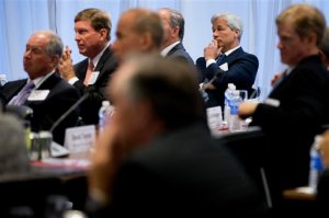 JPMorgan Chase Chairman, President and CEO Jamie Dimon, right, listens as President Barack Obama speaks to business leaders at the quarterly meeting of the Business Roundtable in Washington, Wednesday, Sept. 16, 2015, to renew his calls for increased spending in infrastructure, education and scientific research. (AP Photo/Andrew Harnik)