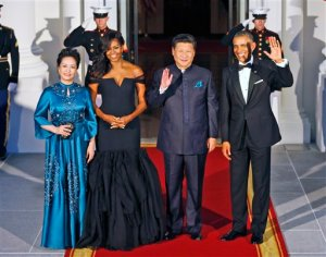 President Barack Obama, right, and Chinese President Xi Jinping, second from right, wave on the North Portico with wives Peng Liyuan, left, and first lady Michelle Obama as they arrive for a State Dinner at the White House in Washington, Friday, Sept. 25, 2015. (AP Photo/Steve Helber)
