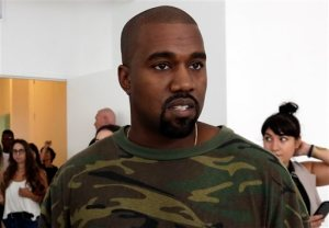 FILE - In this Sept. 10, 2015 file photo, Kanye West appears at the Brother Vellies Spring 2016 collection presentation during Fashion Week, in New York. West's presentation during New York Fashion Week, Wednesday, Sept. 16, showed off his baggy and rural collection in a militant style as Anna Wintour, Lorde and Kim Kardashian _ holding baby North West _ sat front row. West debuted Yeezy Season 2 on Wednesday at the Skylight Modern in New York. (AP Photo/Richard Drew, File)