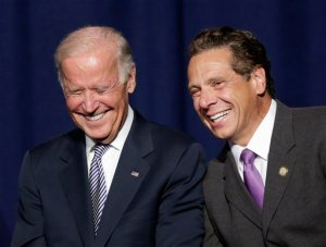 Vice President Joe Biden and New York Gov. Andrew Cuomo laugh prior to speaking at a labor rally, Thursday, Sept. 10, 2015, in New York. Cuomo is proposing to raise the state minimum wage to $15 an hour. (AP Photo/Mark Lennihan)