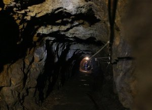 """A view of a tunnel and shelter approximately 50 meters under Ksiaz Castle that the Nazis were building for Hitler's safety and that were part of a giant system of tens of kilometers of tunnels. in Walbrzych, Poland, on Thursday, Sept. 3, 2015, Polish authorities recently said that two unidentified men used radar to locate an armored train deep under the woodlands around Walbrzych, and believe it could be the so-called Nazi """"gold train."""" Rumors have swirled for decades about the train, also said to be filled with weapons, though there is absolutely no evidence that it ever existed. (AP Photo/Czarek Sokolowski)"""