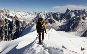 FILE - In this file photo taken on Oct. 12, 2011, an alpinist heads down a ridge on the Aiguille du Midi (3,842 meters; 12 605 feet), towards the Vallee Blanche on the Mont Blanc massif, in the Alps, near Chamonix, France. The Alps are the birthplace of downhill skiing and a crucible for mountain climbers everywhere _ and now the French government is trying to help towns at the heart of the lucrative tourism industry adapt to a warming world. (AP Photo/David Azia,File)