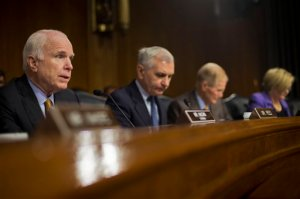 Senate Armed Services Committee Chairman Sen. John McCain, R-Ariz., left, questions US Central Command Commander Gen. Lloyd Austin III, on Capitol Hill in Washington, Wednesday, Sept. 16, 2015,during the committee's hearing on US military operations to counter the Islamic State in Iraq. From left are, McCain, the committee's ranking member, Sen. Jack Reed, D-R.I., Sen. Bill Nelson, D-Fla., and Sen. Claire McCaskill, D-Mo. (AP Photo/Pablo Martinez Monsivais)