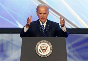 "Vice President Joe Biden speaks at the Solar Power International Trade Show in Anaheim, Calif., Wednesday, Sept. 16, 2015. Taking aim at his potential political opponents, Biden railed against Republicans who ""deny climate change"" and want to shut down the federal government over funding for Planned Parenthood, and pleaded with them to ""just get out of the way."" (AP Photo/Christine Cotter)"