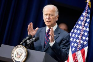 FILE - In this Monday, Sept. 21, 2015, file photo, Vice President Joe Biden speaks at a White House Champions of Change Law Enforcement and Youth meeting, in the South Court Auditorium of the Eisenhower Executive Office Building on the White House complex in Washington. CNN said Monday, Sept. 28, 2015, it will allow Biden to participate in the first Democratic presidential primary debate even if he decides that day to be a candidate. (AP Photo/Andrew Harnik, File)