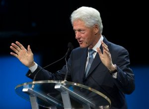 """FILE - In this Aug. 29, 2015 file photo, former President Bill Clinton speaks in New Orleans. Bill Clinton is """"ready to get out there"""" and campaign. With his wife facing an increasingly tough primary battle, the big dog is gearing up to get into the fight. (AP Photo/Max Becherer. File)"""