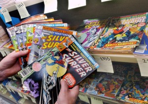 FILE - In this Dec. 29, 2004, file photo, Didier Gaboulaud, head of the French National Museum for Comic Books and Images, displays some of the comics donated by Marvel Enterprises, at the museum in Angouleme, western France. One of the country's top writers about race, Ta-Nehisi Coates, has signed up with Marvel Comics for a Black Panther series. The new, year-long series begins next spring, Marvel announced Tuesday, Sept. 22, 2015. (AP Photo/Bob Edme, File)