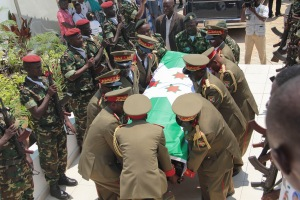 Army officers carry the casket of  Lt. Gen. Adolphe Nshimirimana, during his funeral in Bujumbura, Burundi, Saturday, Aug. 22, 2015. Government officials, relatives and friends on Saturday attended an emotional funeral service for Lt. Gen. Adolphe Nshimirimana, the former intelligence chief and key ally of the president who was assassinated earlier this month in the Burundian capital of Bujumbura. (AP Photo/Berthier Mugiraneza)