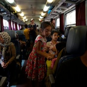Hungary opens door to trains for migrants, but only tocamps
