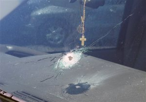 This undated photo released by the Arizona Department of Public Safety shows a bullet hole in the windshield of a vehicle in Phoenix. Four vehicles traveling on the same freeway in the heart of Phoenix have been struck by gunshots in the last week, and the state police agency is appealing for information from the public as it conducts what it says is a robust investigation. (Arizona Department of Public Safety via AP)