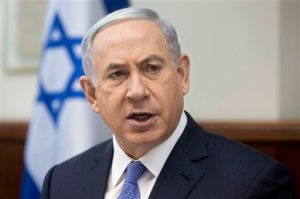 """FILE -  In this Sunday, June 7, 2015, file photo, Israeli Prime Minister Benjamin Netanyahu attends the weekly cabinet meeting in his Jerusalem office. Israel's prime minister will convene an """"emergency meeting"""" over recent Palestinian attacks, an official at his office said Monday hours after a man died from wounds sustained when rocks were thrown at his car and violence broke out at Jerusalem's most sensitive holy site for a second day in a row. (AP Photo/Sebastian Scheiner, File)"""