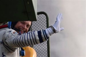 Denmark's astronaut Andreas Mogensen, member of the main crew of the mission to the International Space Station (ISS), gestures near the rocket prior the launch at the Russian leased Baikonur cosmodrome, Kazakhstan, Wednesday, Sept. 2, 2015. (Kirill Kudryavtsev/Pool Photo via AP)