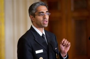 """FILE - In this Aug. 3, 2015, file photo, U.S. Surgeon General Vivek Murthy speaks in the East Room at the White House in Washington. Take a walk: That's the U.S. surgeon general's prescription for sedentary Americans _ but communities will have to step up, too, and make neighborhoods easier and safer for foot traffic. Only half of adults and just over a quarter of high school students get the amount of physical activity recommended for good health, Murthy said in a """"call to action"""" being issued Sept. 9. (AP Photo/Andrew Harnik, File)"""