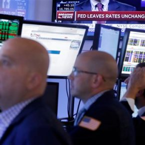 Stocks close lower after Fed keeps interest rates low