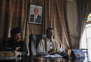 CORRECTS DEPUTY GOVERNOR'S FIRST NAME TO ABDUL - Abdul Rab Ali, the deputy governor of Marib province, right, speaks to journalists alongside Mohammed al-Qahim, the provincial head of security, in Marib, Yemen, Thursday, Sept. 17, 2015. The Saudi-led coalition targeting Yemen's Shiite rebels pounded the insurgents' positions Thursday with heavy artillery fire on the outskirts of the central city of Marib, part of their push to retake the capital, Sanaa. (AP Photo/Adam Schreck)