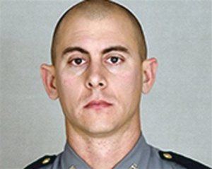 This undated photo provided by the Kentucky State Police shows Trooper Joseph Cameron Ponder. Ponder, who had been on the force less than a year was killed, late Sunday, Sept. 13, 2015, in a shooting during a car chase on Interstate 24, in Kentucky. Authorities are searching for the suspect. (Courtesy of the Kentucky State Police via AP)