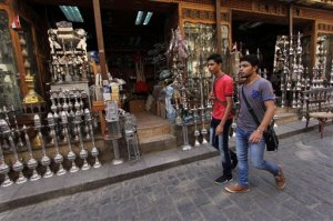 Shoppers walk through Cairo's Khan el-Khalili bazaar in Egypt, Tuesday, Sept. 15, 2015. Sunday's airborne attack by Egyptian forces on tourists in the western desert, among the deadliest involving tourists in Egypt, came as the country has been trying to revive its vital tourism industry since the turmoil following the 2011 uprising that toppled President Hosni Mubarak. (AP Photo/Mohammed Abu Zaid)