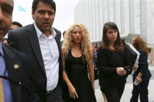 UNICEF and United Nations Goodwill Ambassador Shakira, center, is escorted by her security as she leaves the U.N. headquarters, Tuesday, Sept. 22, 2015 at United Nations headquarters. Shakira held a news conference on early childhood education. (AP Photo/Mary Altaffer)