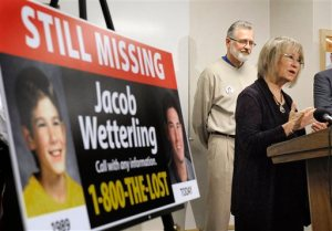 "FILE - In this Oct. 14, 2014 file photo, Patty, right, and Jerry Wetterling take part in a news conference at the Stearns County Law Enforcement Center in St. Cloud, Minn., to announce the installation of six new billboards that will be placed near where their son Jacob was abducted in 1989. Federal authorities said Thursday, Oct. 29, 2015, Daniel James Heinrich, a Minnesota man charged with child pornography after a search of his home found pictures of naked boys is also a ""person of interest"" in the disappearance of Jacob Wetterling, whose 1989 abduction led his parents to launch a national center to prevent child exploitation.  (Dave Schwarz/St. Cloud Times via AP, File)  NO SALES; MANDATORY CREDIT"