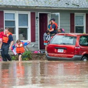 1 dies in flooding as storms threaten to move up East Coast