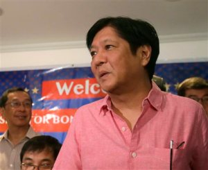 "Philippine Senator Ferdinand ""Bongbong"" Marcos Jr. arrives for a media forum Wednesday, Oct.7, 2015, two days after announcing he is seeking the nation's second highest office in next year's national elections, at suburban Quezon city northeast of Manila, Philippines. Marcos Jr., the son of the late strongman Ferdinand Marcos,  said that Filipinos are no longer concerned with abuses committed under his father's rule, angering human rights activists who say he wants people to forget his father's strongman rule that a popular revolt ended 29 years ago. (AP Photo/Bullit Marquez)"