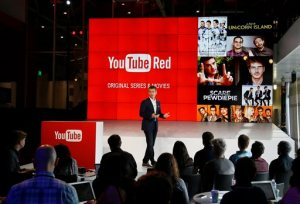 "Robert Kyncl, YouTube Chief Business Officer, speaks as YouTube unveils ""YouTube Red,"" a new subscription service including original programming, at YouTube Space LA offices Wednesday, Oct. 21, 2015, in Los Angeles. The service combines ad-free videos, new original series and movies from top YouTubers like PewDiePie, and on-demand unlimited streaming music for $10 a month. (AP Photo/Danny Moloshok)"
