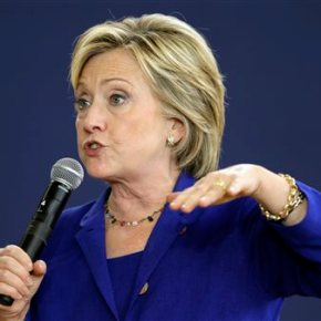 Clinton questions plans for health insurers tomerge