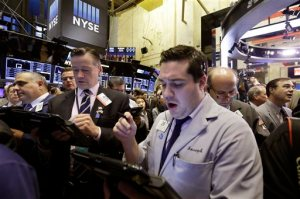 Stock traders work at the New York Stock Exchange, Thursday, Oct. 15, 2015. Stocks are opening slightly higher following two days of losses as investors respond to some positive earnings surprises. (AP Photo/Richard Drew)