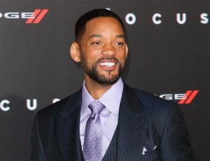 "FILE - In this Feb. 24, 2015 file photo, Will Smith arrives at the world premiere of ""Focus"" in Los Angeles. The Grammy-winning rapper and Oscar-nominated actor appears on a remix to Colombian band Bomba Estereo's song, ""Fiesta."" The remix was released digitally Friday, Oct. 2. The collaboration marks Smith's return to music since his 2005 album, ""Lost and Found."" Smith discovered Bomba Estereo, known for its blend of Latin, tropical and electro sounds, on a recent trip to Colombia. He then asked the group to collaborate. (Photo by John Salangsang/Invision/AP, File)"