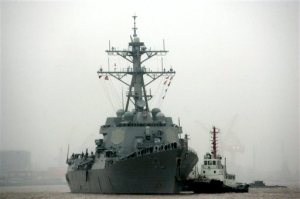 "In this April 8, 2008, file photo, guided missile destroyer USS Lassen arrives at the Shanghai International Passenger Quay in Shanghai, China, for a scheduled port visit. Just two days after the USS Lassen sailed past one of China's artificial islands in the South China Sea in a challenge to Chinese sovereignty claims, Defense Ministry spokesman Col. Yang Yujun said Thursday that China will take ""all necessary"" measures in response to any future U.S. Navy incursions into what it considers its territorial waters around the islands. (AP Photo/Eugene Hoshiko, File)"