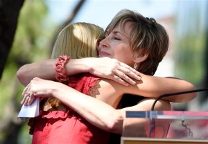 "Actress Claire Danes, left, gets a hug from Bess Armstrong, a fellow cast member on the television series ""My So-Called Life,"" during a ceremony to award Danes a star on the Hollywood Walk of Fame on Thursday, Sept. 24, 2015, in Los Angeles. (Photo by Chris Pizzello/Invision/AP)"