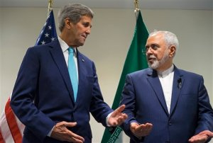 FILE - In this Saturday, Sept. 26, 2015 file photo, US Secretary of State John Kerry, left, meets with Iranian Foreign Minister Mohammad Javad Zarif at United Nations headquarters. Iran sits down with the United States, Russia, Europeans and key Arab states for the first time since the Syrian civil war began to discuss the future of the war-torn country. It will also break ground by bringing President Bashar Assad's main supporter, Iran, to the same table as its regional rivals, including Turkey and Saudi Arabia, who have been backing many of the insurgent groups. (AP Photo/Craig Ruttle, File)