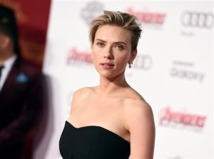 """FILE - In this April 13, 2015, file photo, Scarlett Johansson arrives at the Los Angeles premiere of """"Avengers: Age Of Ultron."""" Johansson is one of many actors lending their voices to audiobooks. She narrated Lewis Carroll's playful """"Alice in Wonderland"""" for Audible. (Photo by Jordan Strauss/Invision/AP, File)"""
