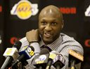 FILE - In this July 31, 2009, file photo, Los Angeles Lakers' Lamar Odom speaks to the media during a news conference after the Lakers signed Odom to a multi-year NBA basketball contract, in El Segundo, Calif. Odom spent most of his 14-year NBA career in Los Angeles with the Lakers and Clippers, becoming a fan favorite before he sought even more fame with the Kardashians. Odom, who was embraced by teammates and television fans alike for his Everyman approach to fame, was found face-down and alone Tuesday, Oct. 13, 2015,  after spending four days at the Love Ranch, a legal Nevada brothel. (AP Photo/Jeff Lewis, File)